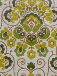 medaillon jaune vert avec des lignes orange