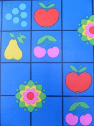 fruit and flowers on a blue background