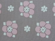 pink flower with white dots on a grey background