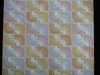 geometrisch behangpapier in pastelkleuren