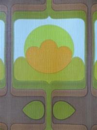 orange, green and brown geometric figure